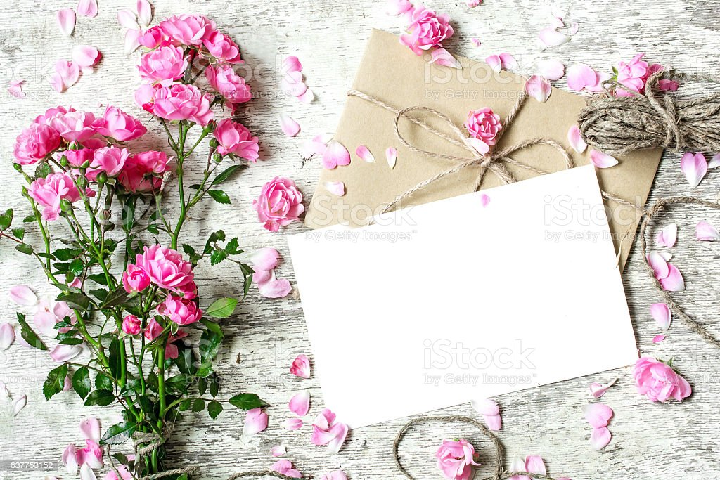 blank white greeting card with pink rose flowers bouquet stock photo