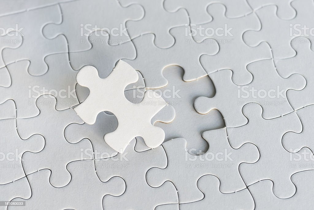 blank white jigsaw puzzle and one piece royalty-free stock photo