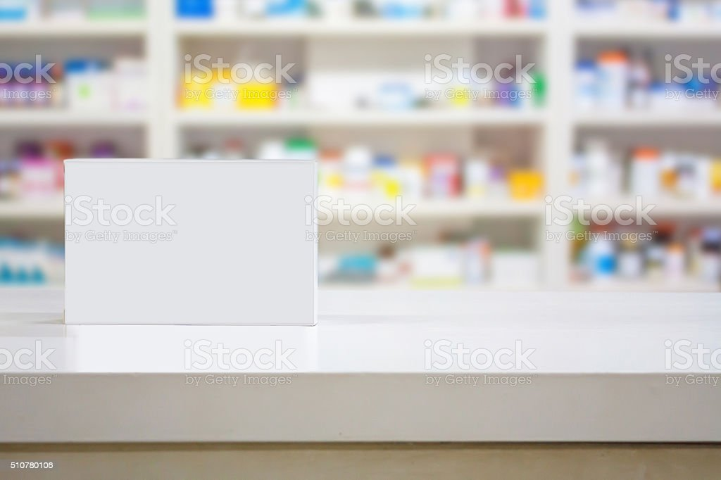 Blank white medicine package on counter in the pharmacy stock photo