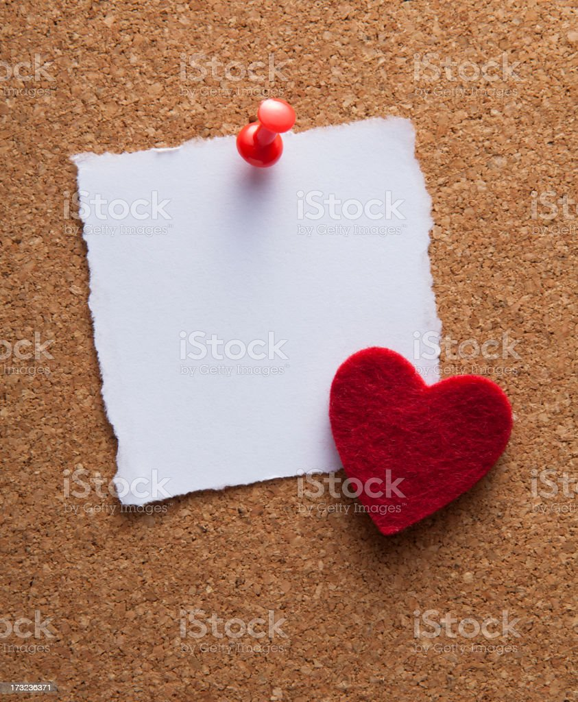blank white note paper on cork board stock photo