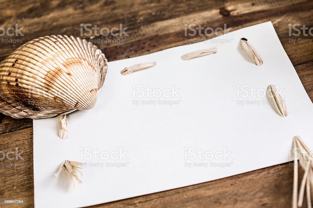 Blank, white notecard with seashell border. stock photo