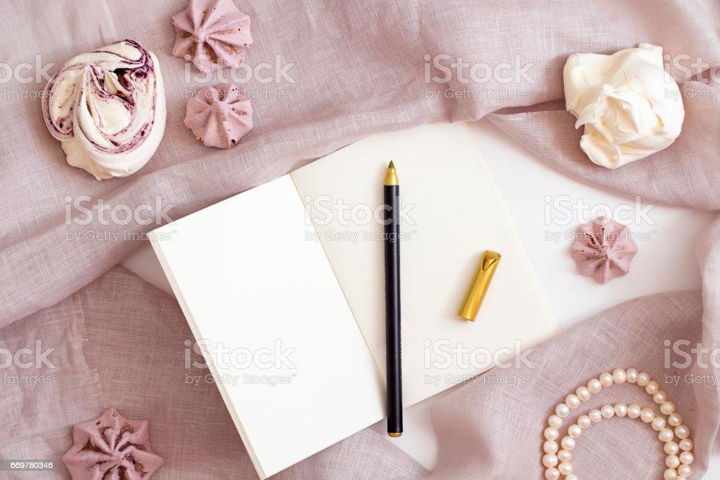 Blank white notepad female flat lay stock photo