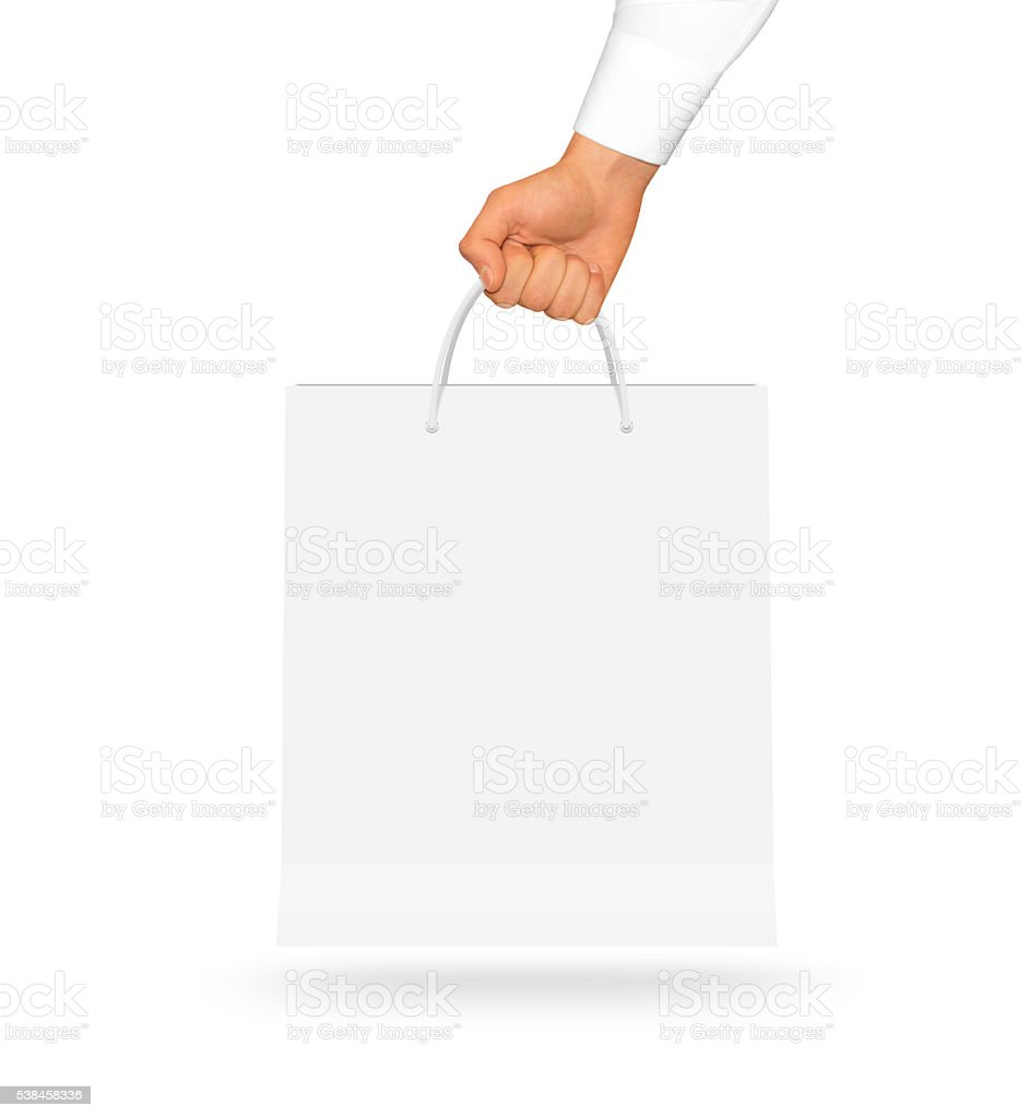Blank white paper bag mock up holding in hand. stock photo