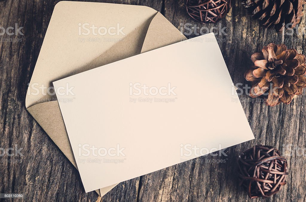 Blank white paper card with brown envelop stock photo