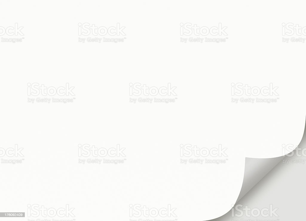 Blank white paper curling at the corner stock photo