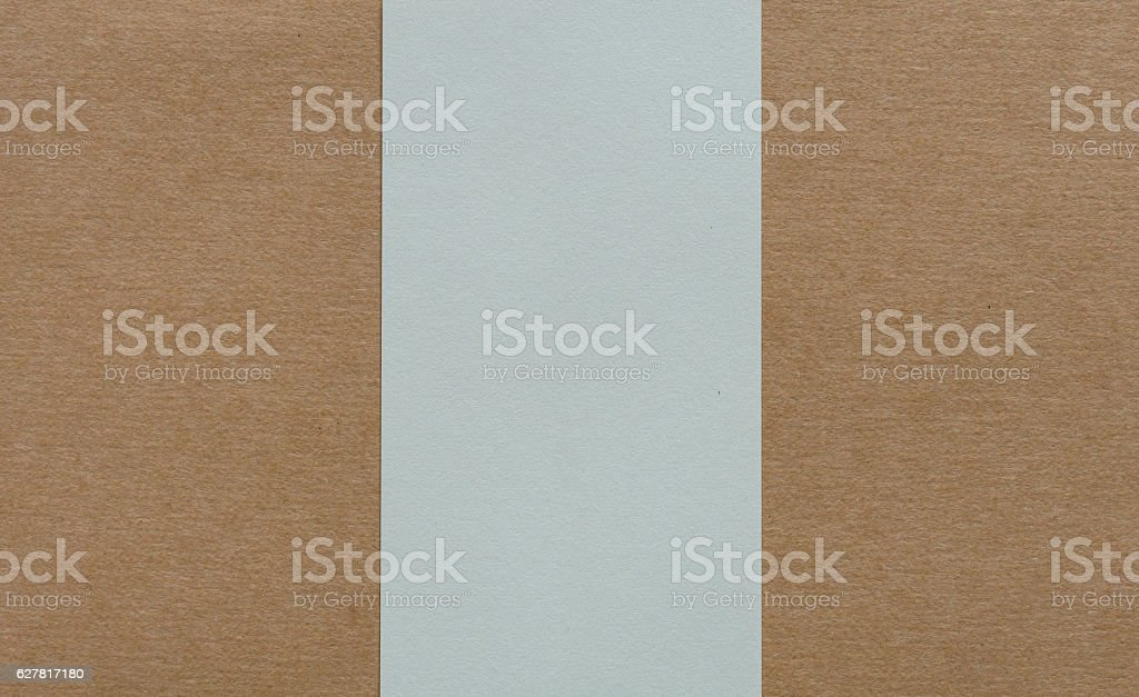 Blank white paper on brown cardboad background stock photo