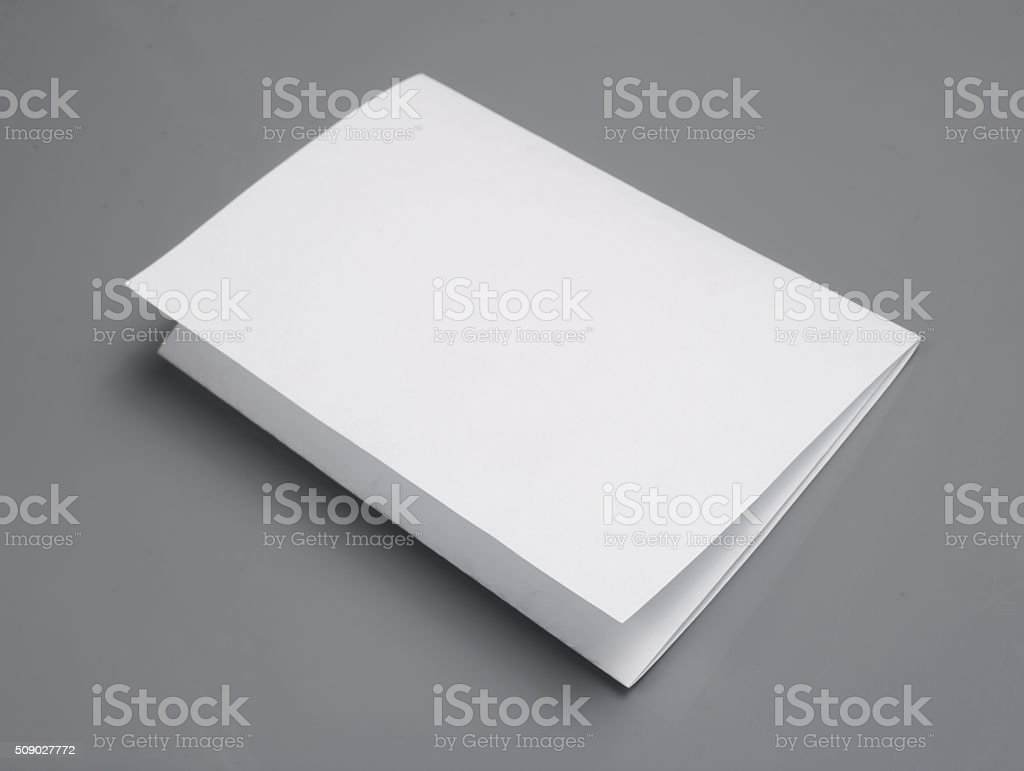 blank white paper with shadows, isolated on gray background stock photo