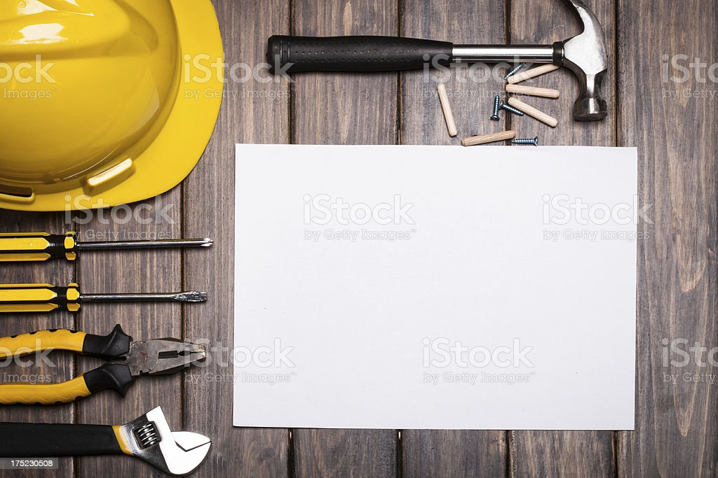 blank white paper with tools on wooden background royalty-free stock photo