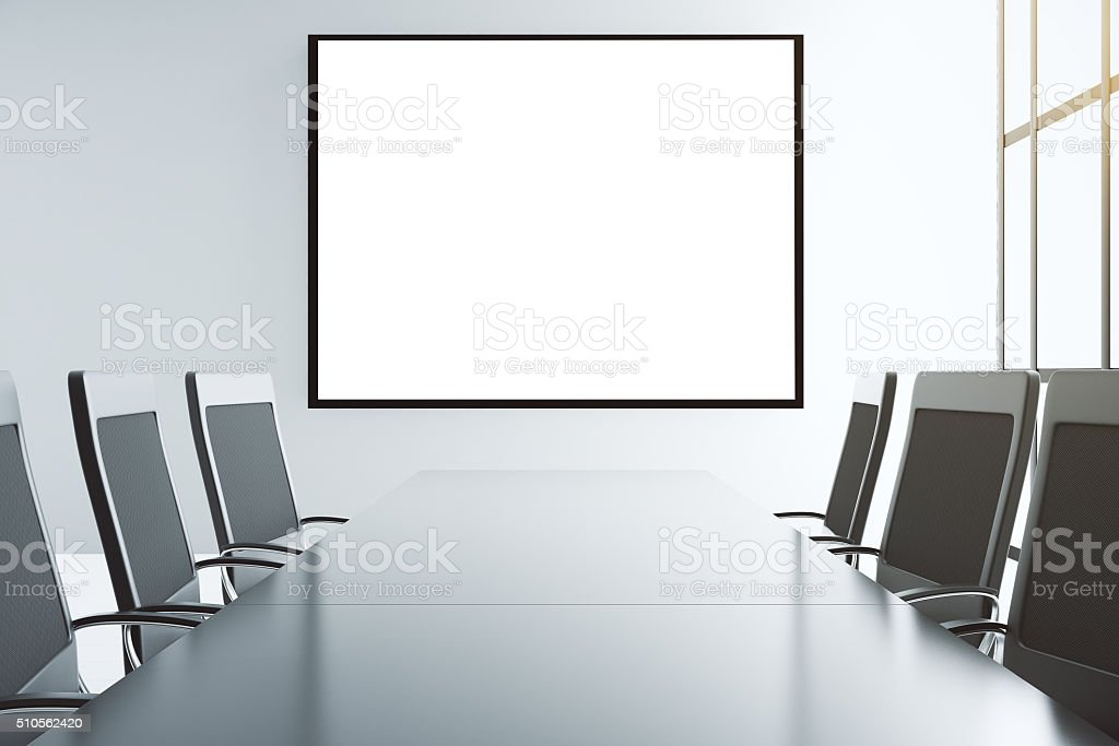 Blank white picture frame on the wall of conference room stock photo