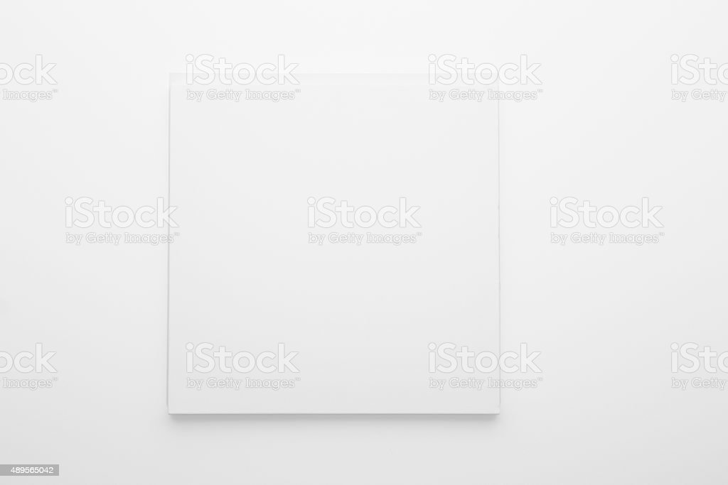Blank white picture on white wall stock photo