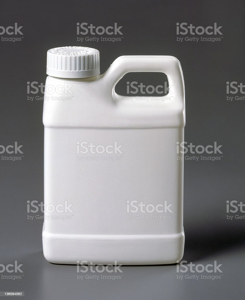 Blank white plastic jug on a gray background royalty-free stock photo