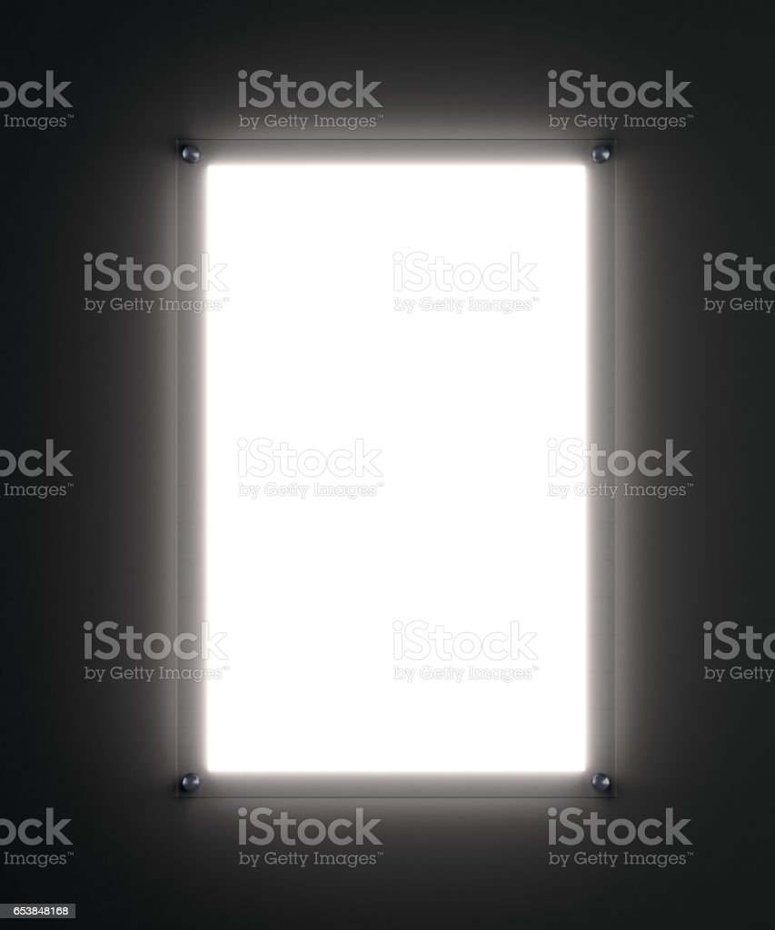 Blank white poster mockup in illuminated glass holder stock photo