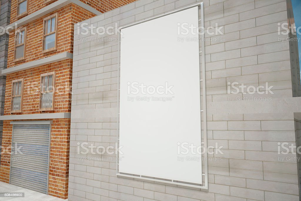 Blank white poster on grey brick wall stock photo