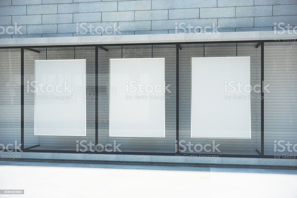 Blank white posters in glassy showcase on the street stock photo