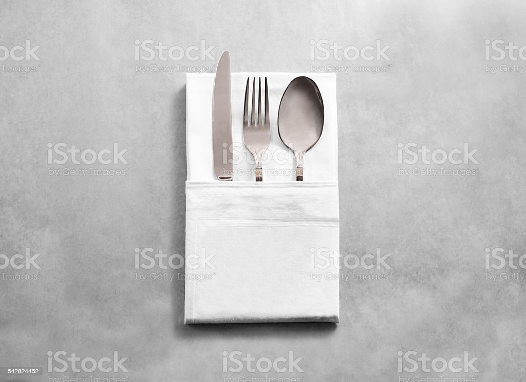 Blank white restaurant cloth napkin mockup with silver cutlery set stock photo