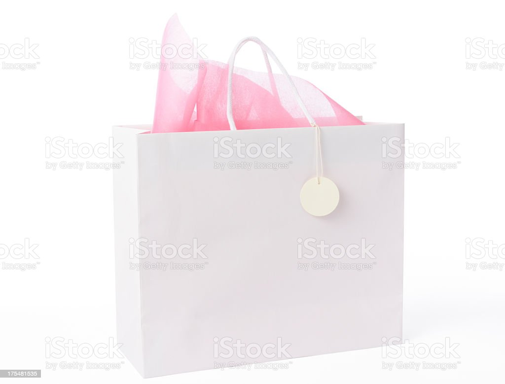Blank white shopping bag with blank tag on white background stock photo
