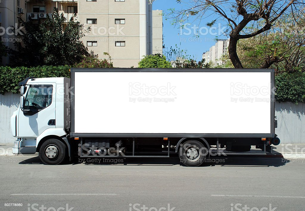 Blank white Sign board on a white truck stock photo