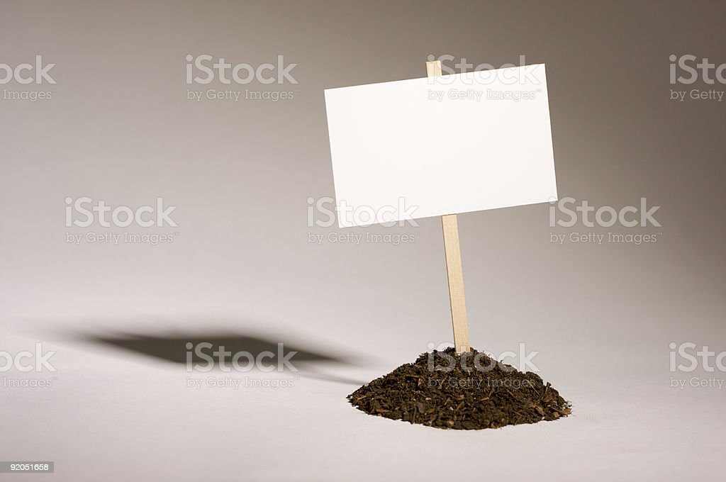 Blank White Sign in Dirt Pile stock photo