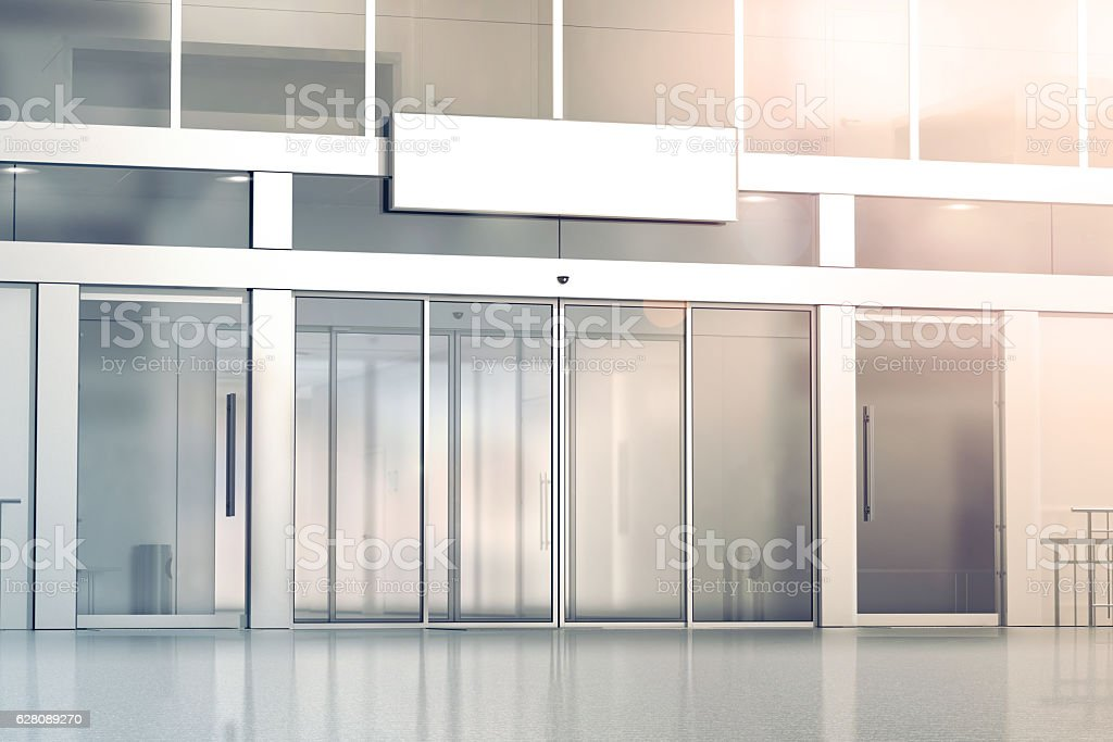 Blank white signage on the store glass doors entrance mockup stock photo