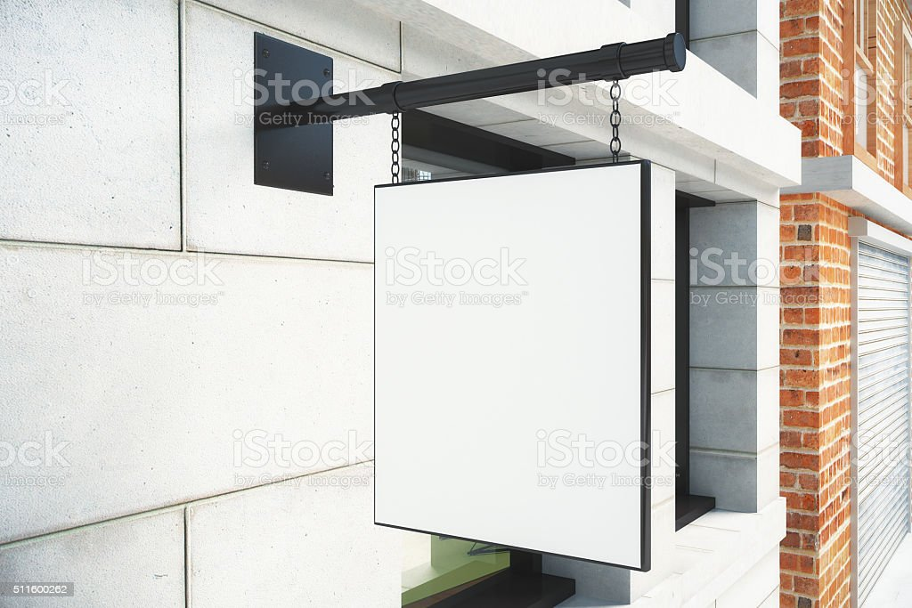 Blank white signboard on bulding wall on city street stock photo