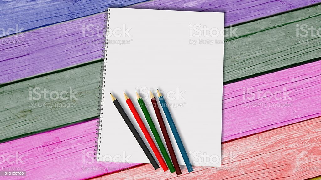 Blank white spiral bound paper drawing pad with color pencil stock photo