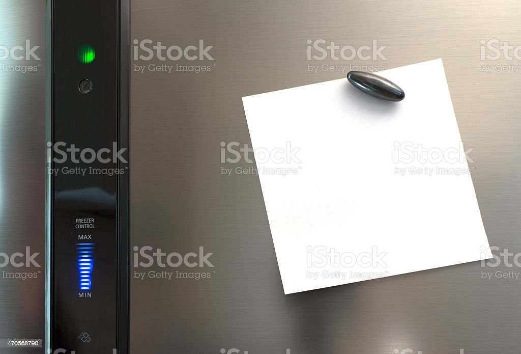 Blank white square note pinned to the fridge stock photo