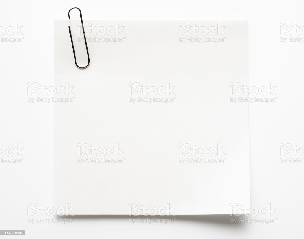 Blank white sticky note with paper clip on white background stock photo