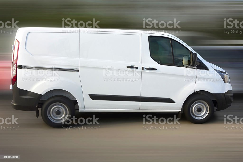 Blank white Van driving on the road stock photo