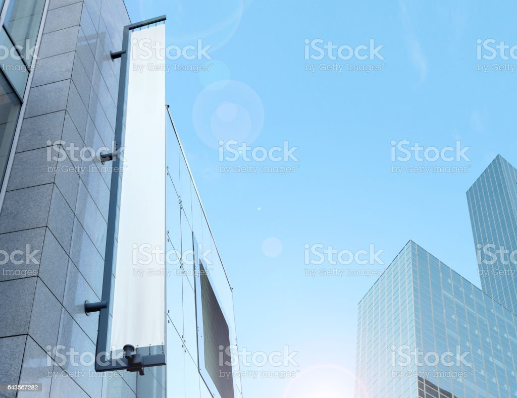 Blank white vertical banner on building facade, design mockup stock photo