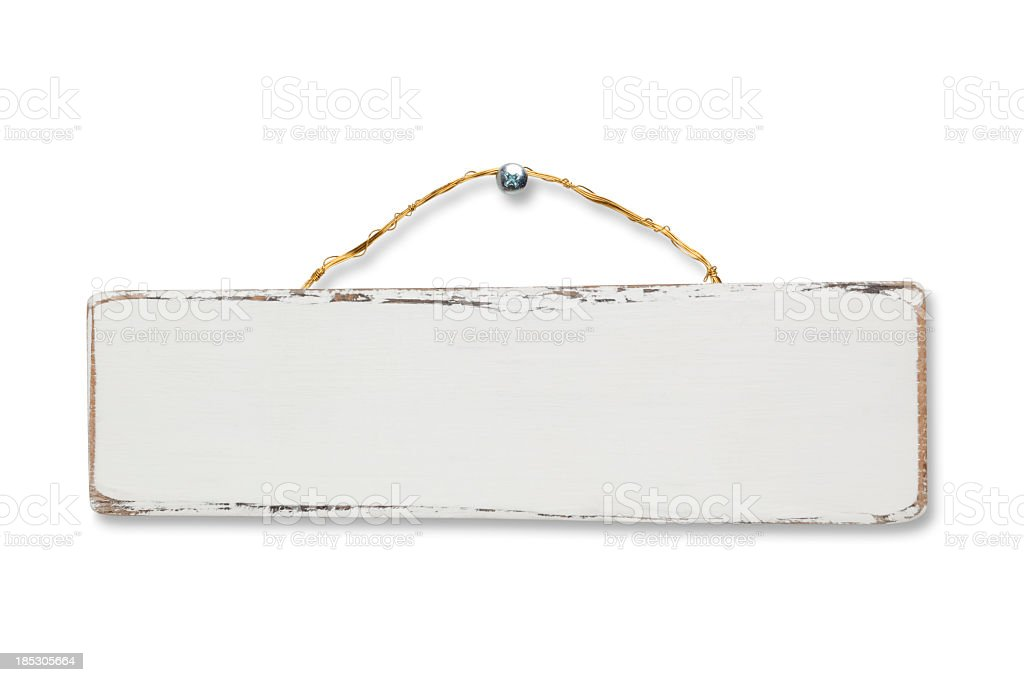 A blank white wooden sign nailed to a wall stock photo