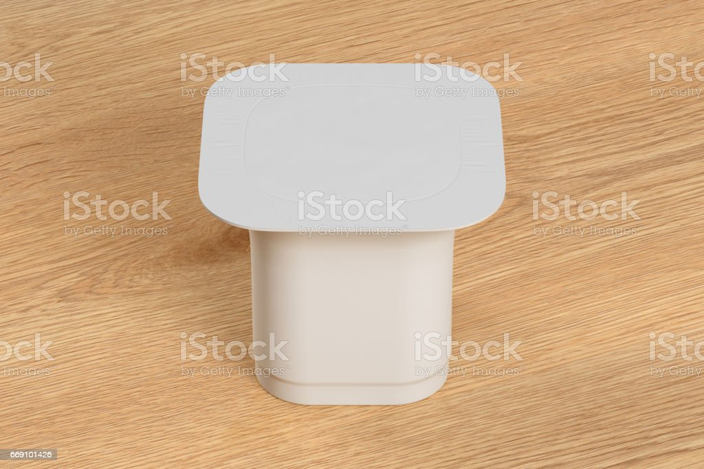Blank white yogurt packaging. Mockup dessert plastic container...