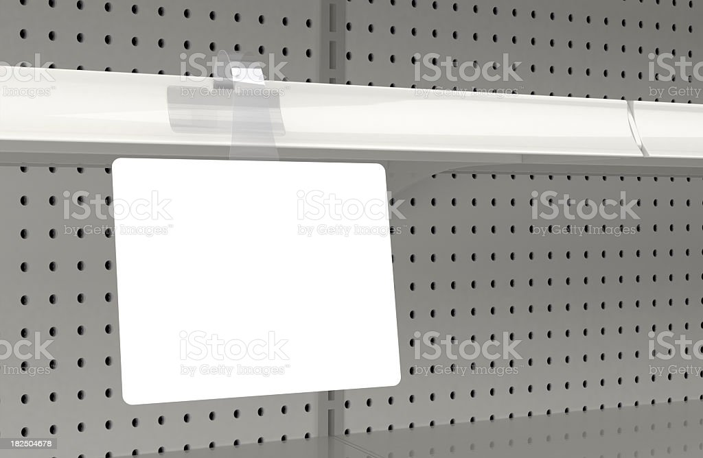 Blank wobbler attached to a retail store shelf royalty-free stock photo
