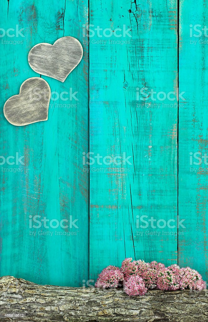 Blank wood background with hearts, log, and stonecrop stock photo