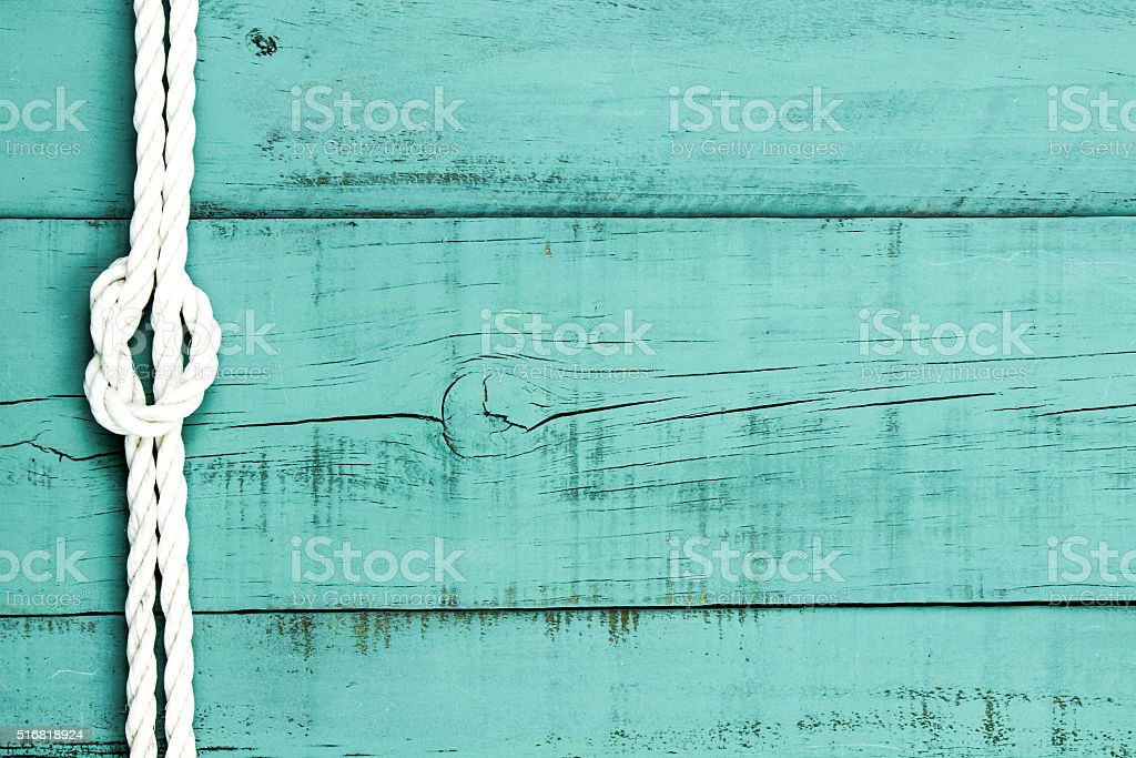 Blank wood sign with white rope border stock photo