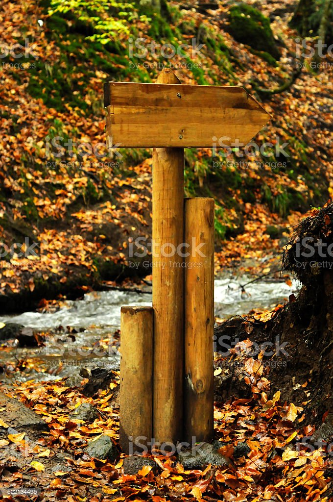 Blank wooden arrow foothpath sign stock photo