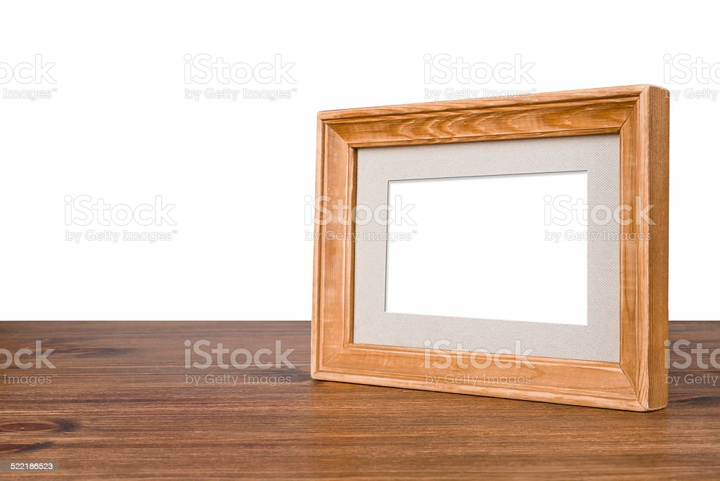 Blank wooden picture frame on table over white background stock photo