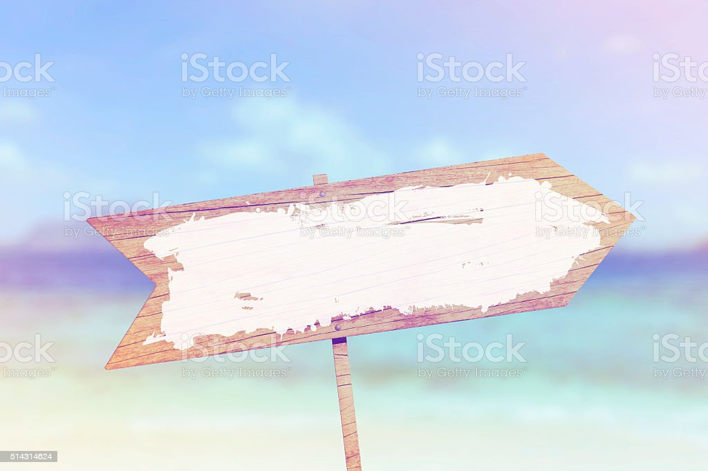 Blank wooden sign against summer beach background stock photo