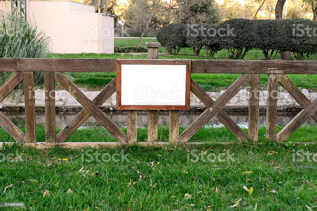 Blank Wooden Sign In The Park stock photo