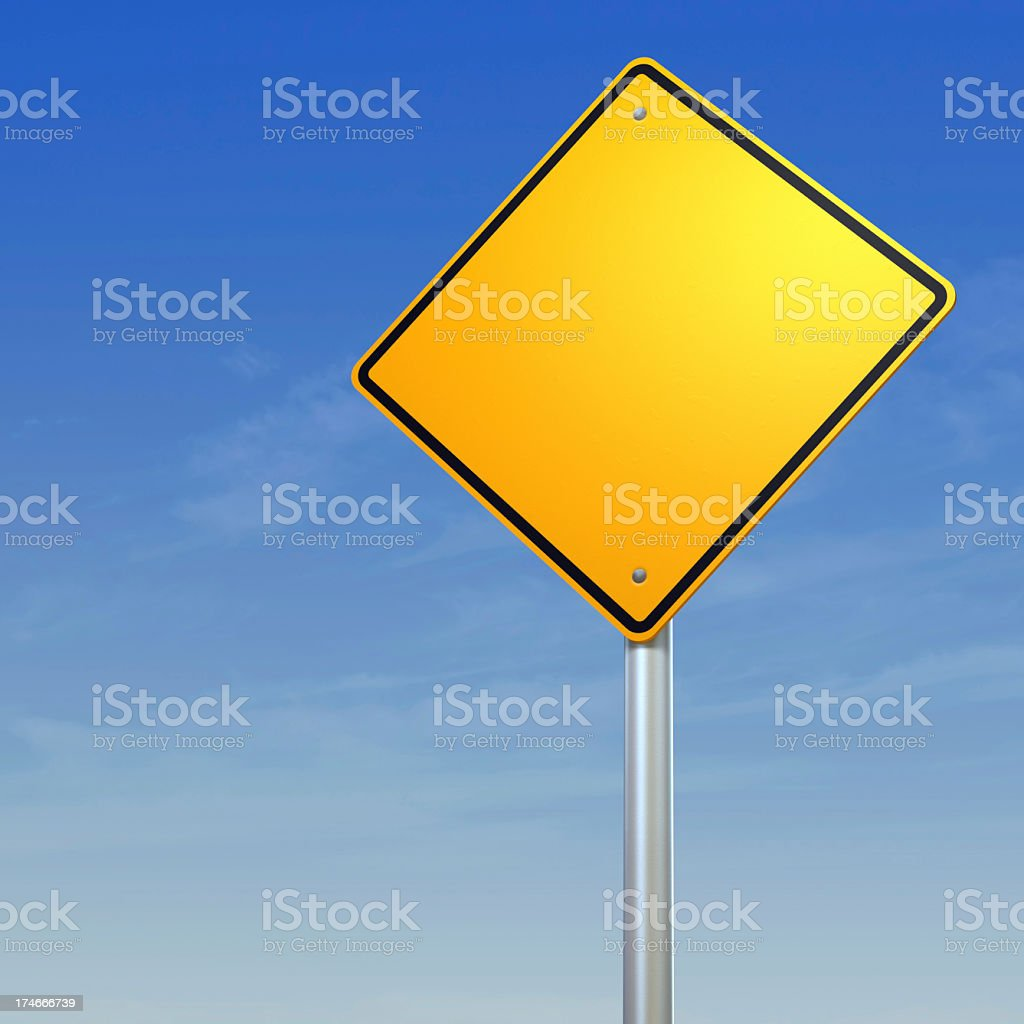 Blank yellow diamond warning sign against a blue sky stock photo