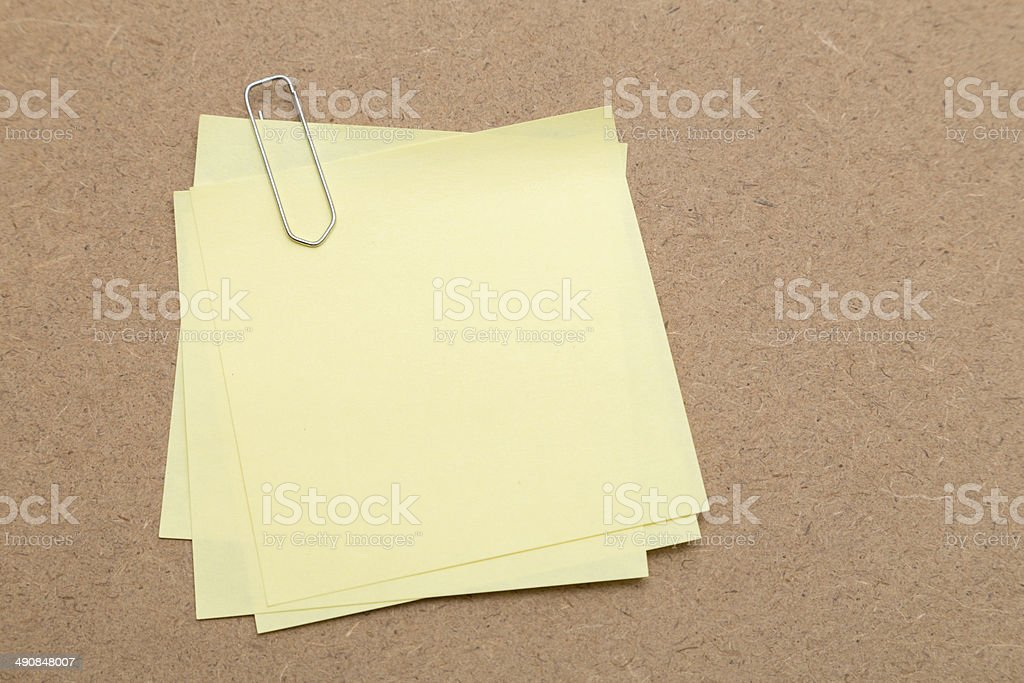Blank Yellow Sticky Note with paper clip stock photo