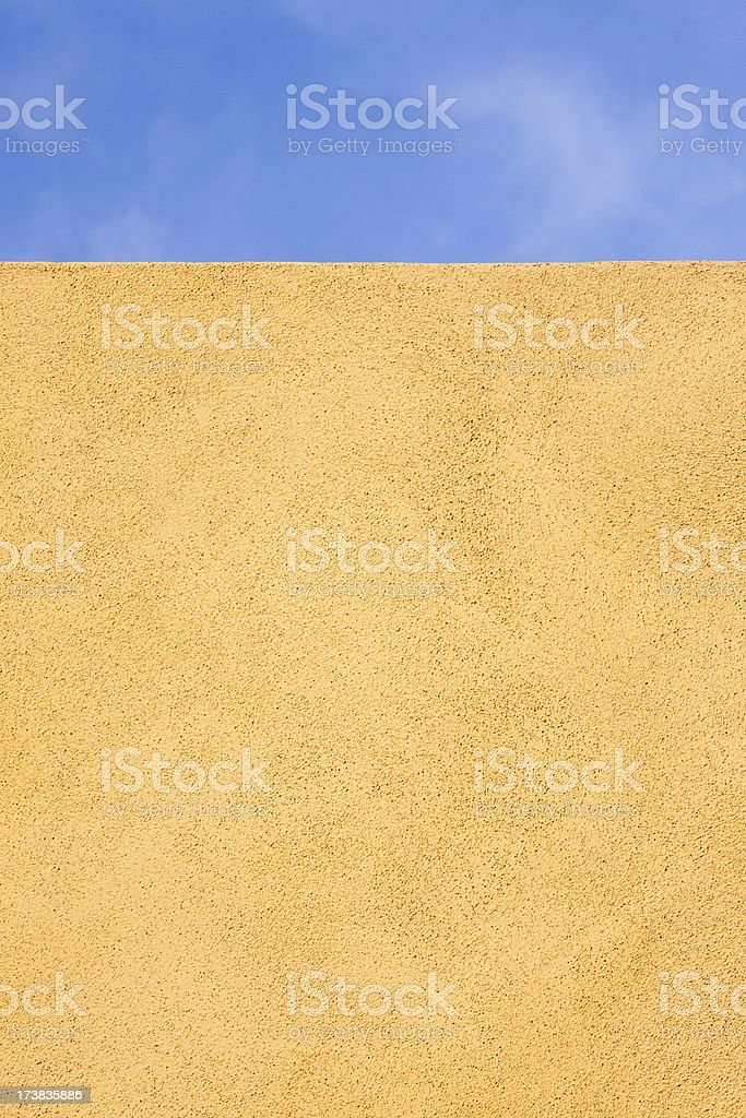Blank Yellow Stucco Wall Against Blue Sky, Background, Copyspace royalty-free stock photo