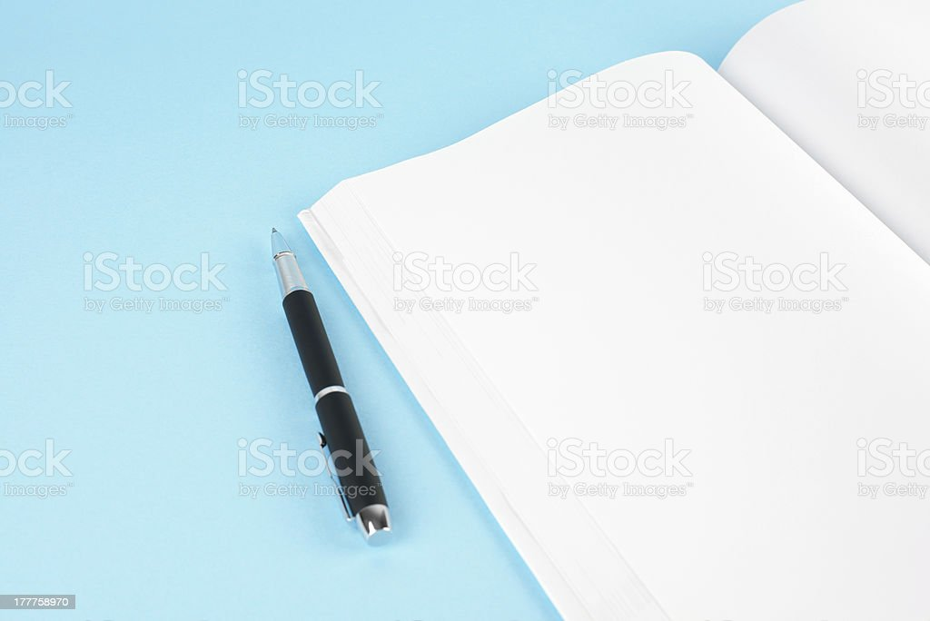 Blank/empty white book and pen royalty-free stock photo