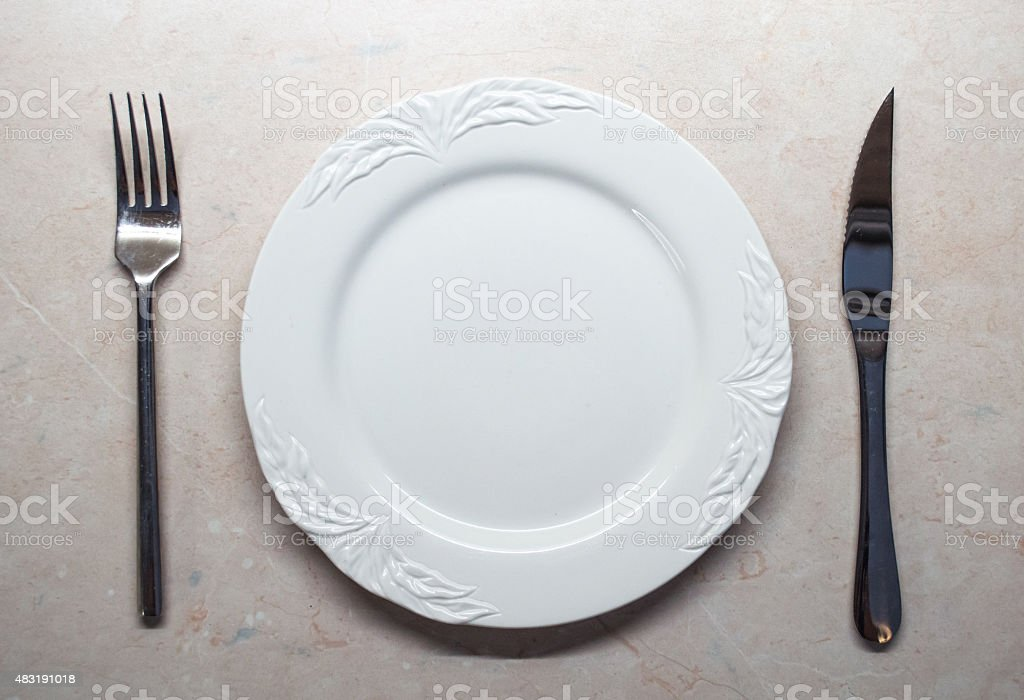 Blank/Empty White Plate with Knife and Fork royalty-free stock photo