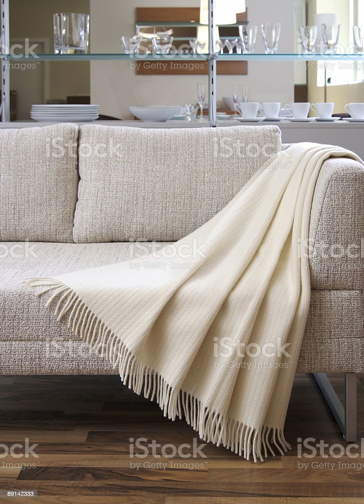 Blanket draped over a settee stock photo