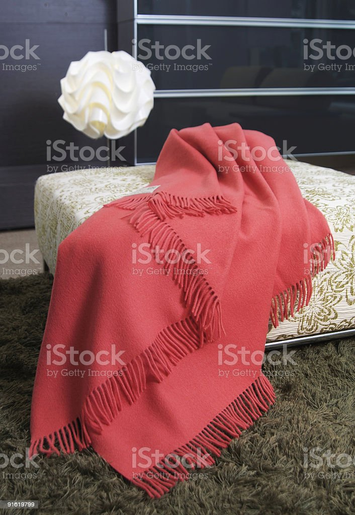 Blanket on an ottoman royalty-free stock photo