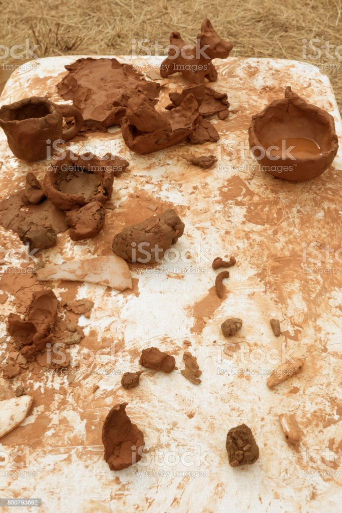 blanks, clay pieces and figurines lie on a white surface stock photo