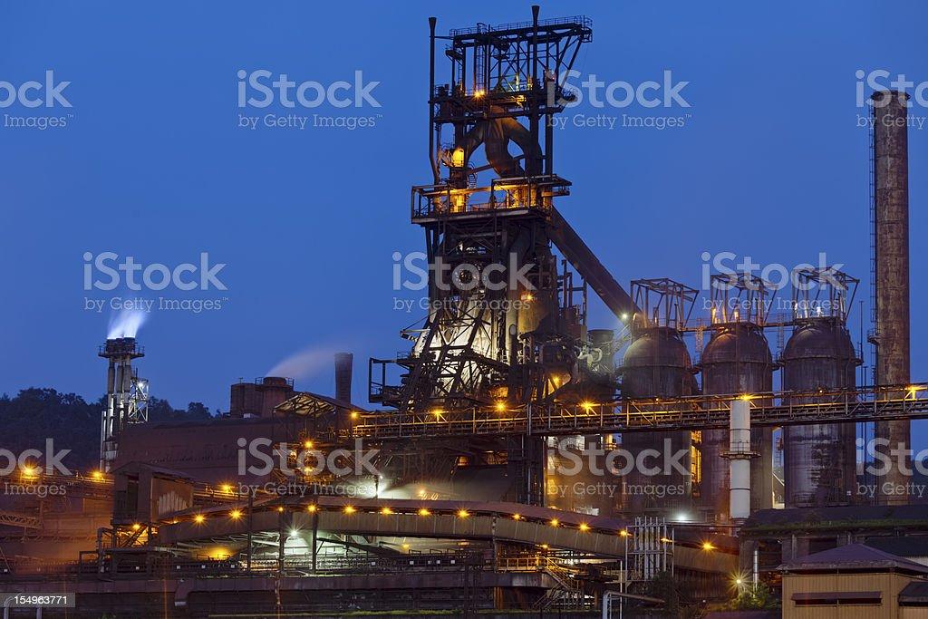 Blast furnace at night stock photo