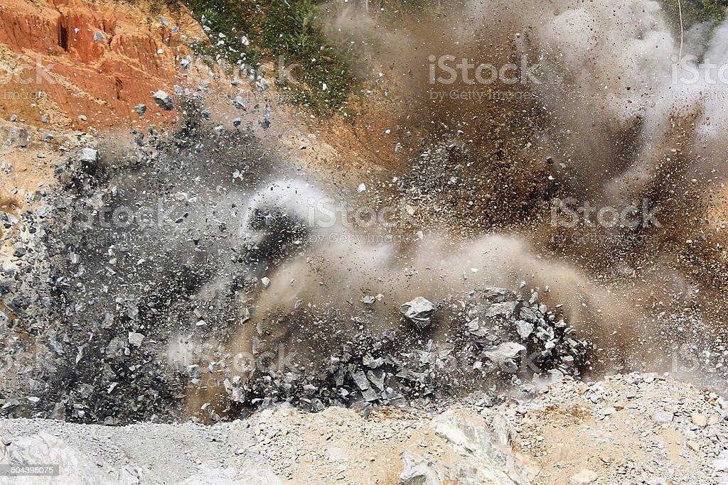 Blast in open cast mining quarry stock photo