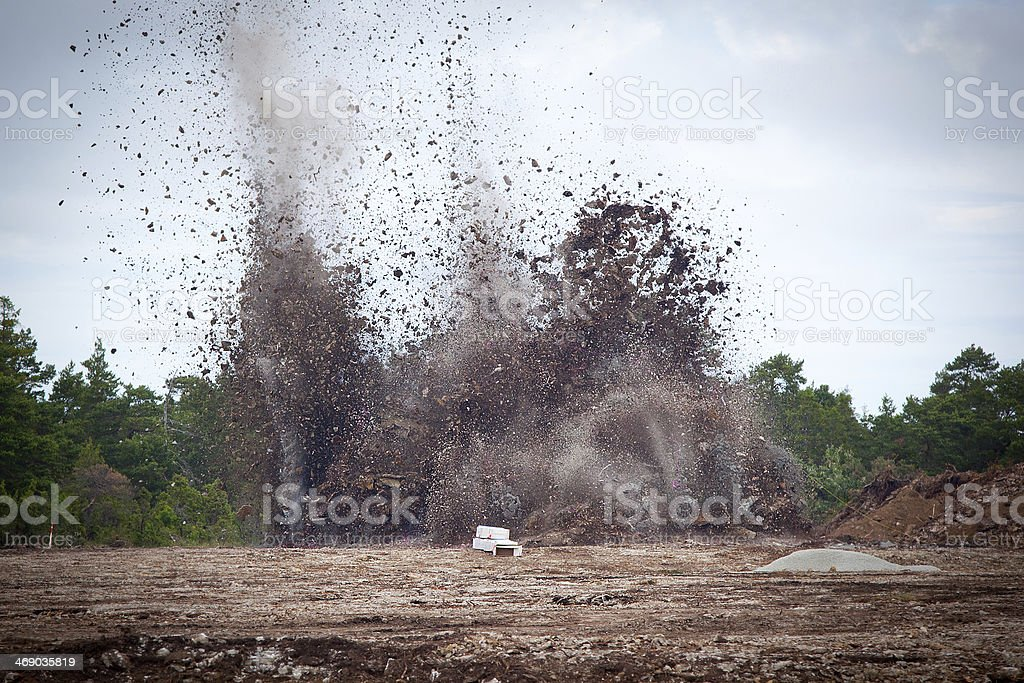 Blasting limestone in a quarry.GN royalty-free stock photo