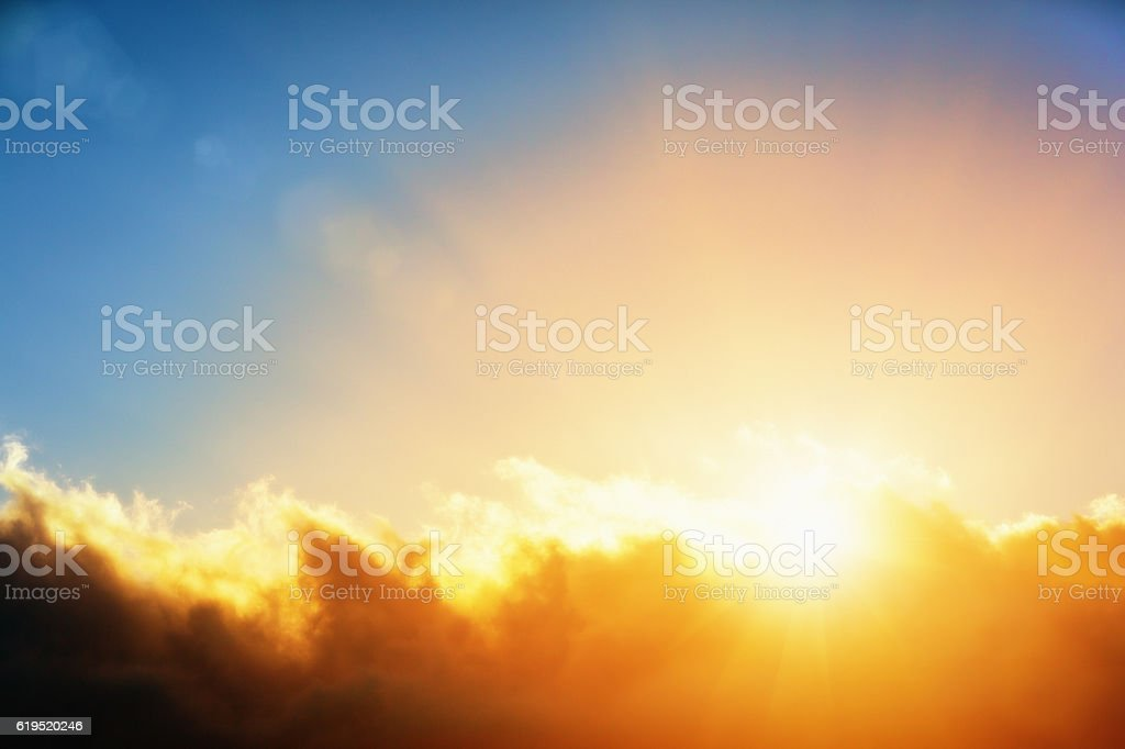 Blaze of Glory: the golden sun emerging from behind cloud stock photo